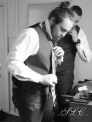 Groomsmen Tying Ties - at Carleton Farms wedding